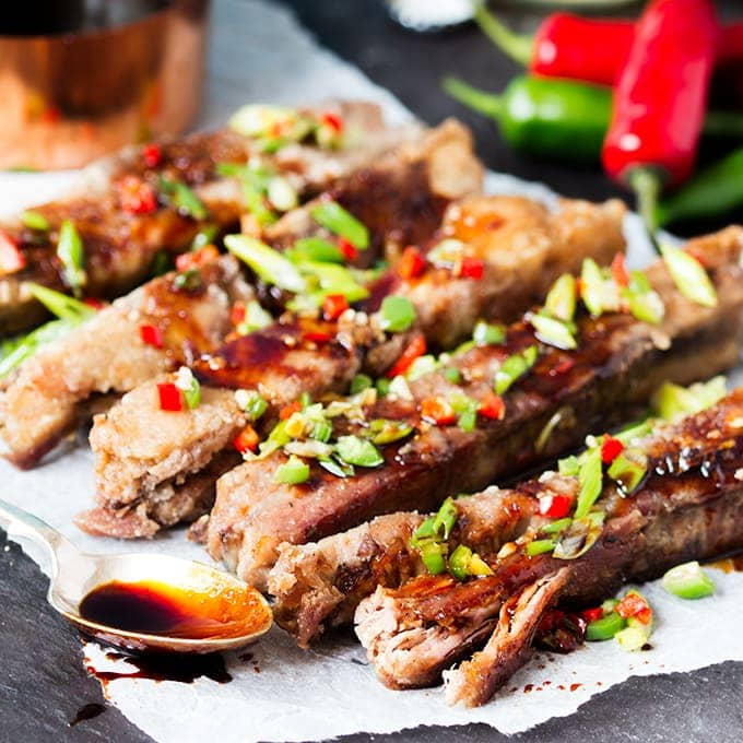 These ribs are fall-apart-tender with a light, crispy coating. Drizzled in a spicy, sticky sauce they're so delicious!