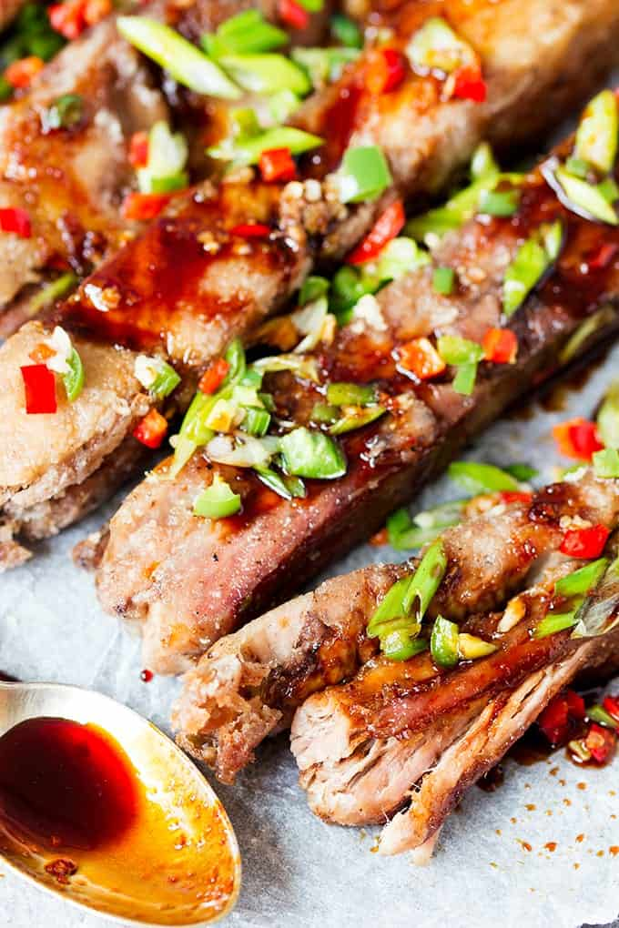 These Salt and Pepper Ribs with Chilli Honey Drizzle are fall-apart-tender with a light, crispy coating. Drizzled in a spicy, sticky sauce they're so delicious!