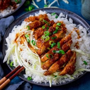 Tonkatsu pork curry on a plate with rice and cabbage