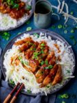 Tonkatsu pork curry on a dark plate with rice and cabbage