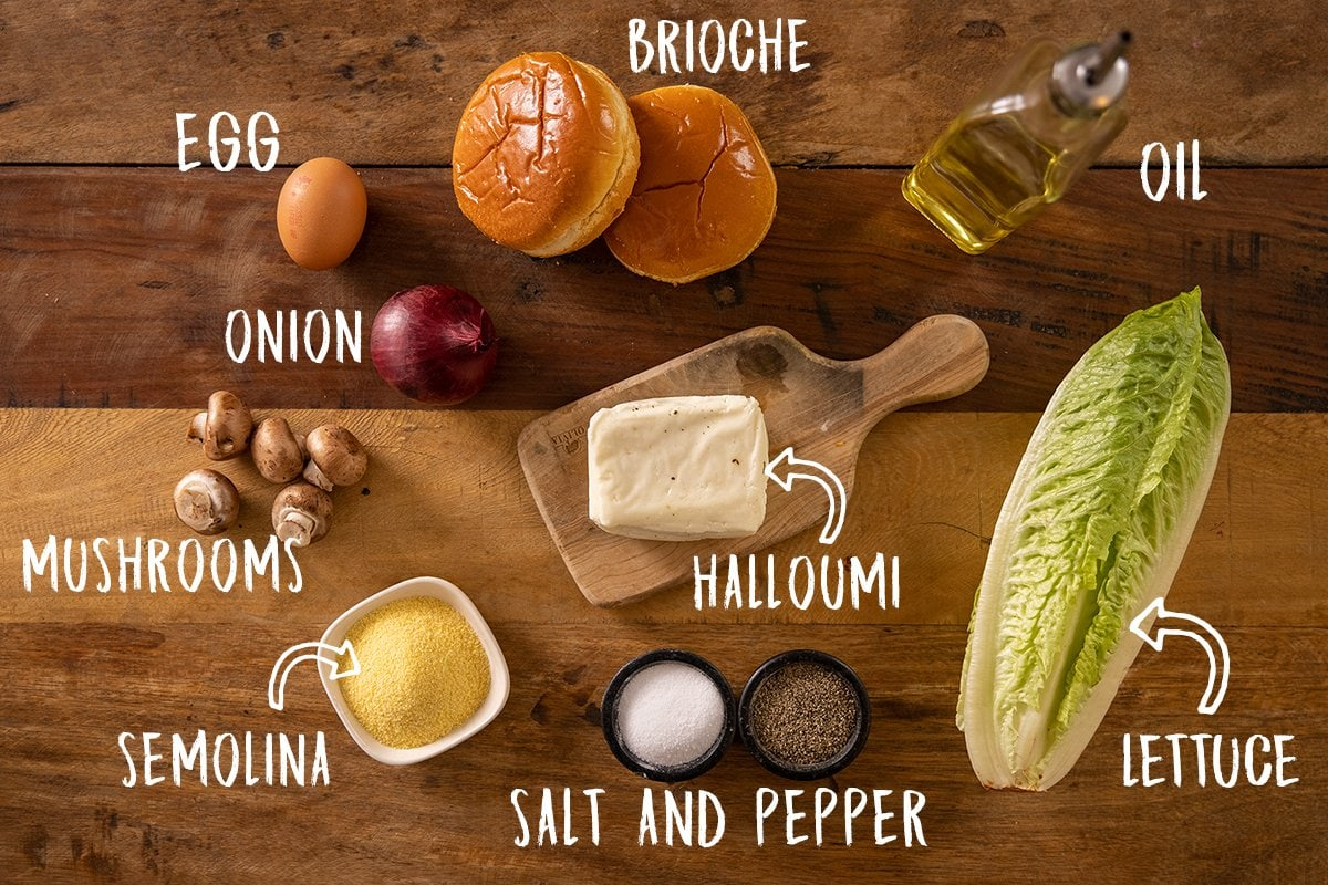 Ingredients for crispy halloumi burgers on a wooden table