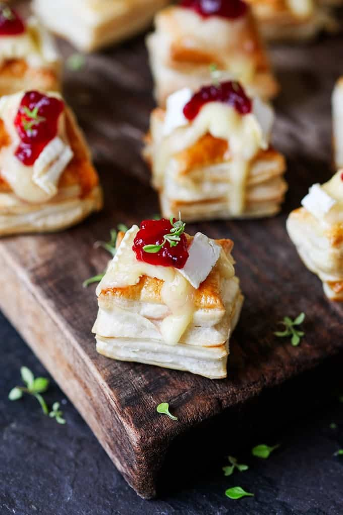Cranberry and Brie bites close up on a wooden board