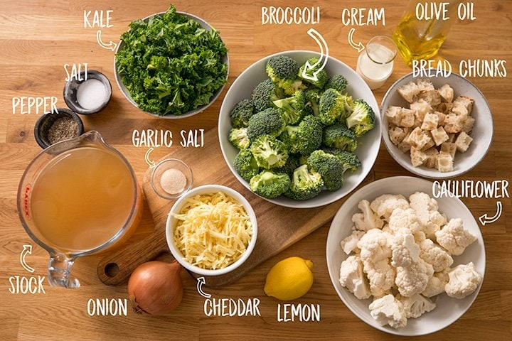 Ingredients for broccoli soup on a wooden table