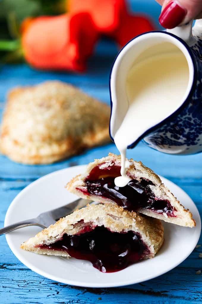 Valentine's Day Cherry Pies. Simple sugar-sprinkled cherry hand pies - a simple but thoughtful gift for your Valentine.