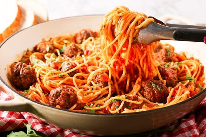 One-pan spaghetti and Meatballs. Meatballs and spaghetti cooked together in one pan – less washing up yay!