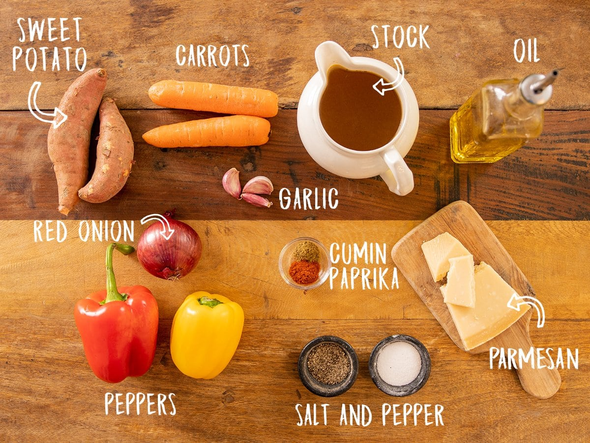Ingredients for Roasted vegetable soup on a wooden table