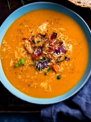 Roasted vegetable soup in a blue bowl