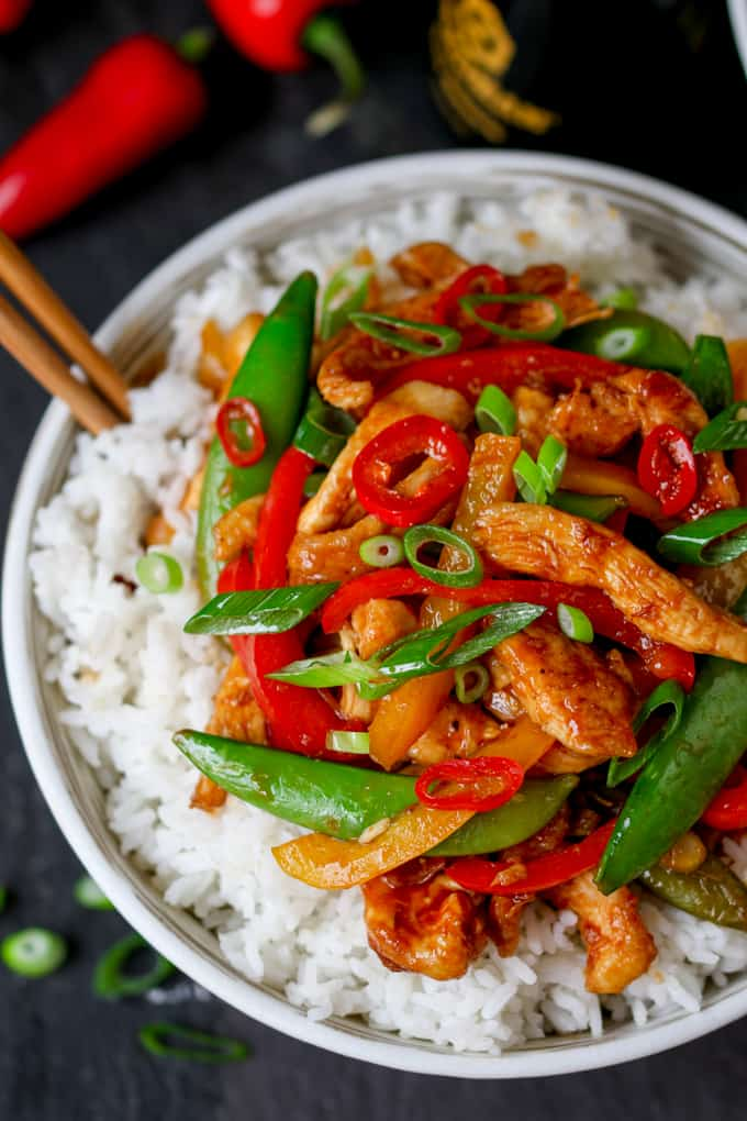 Easy Chicken and veggie stir fry in a bowl on a bed of rice