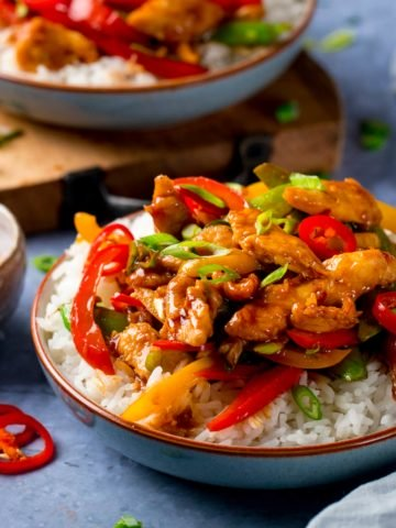 chicken stir fry in a bowl with rice