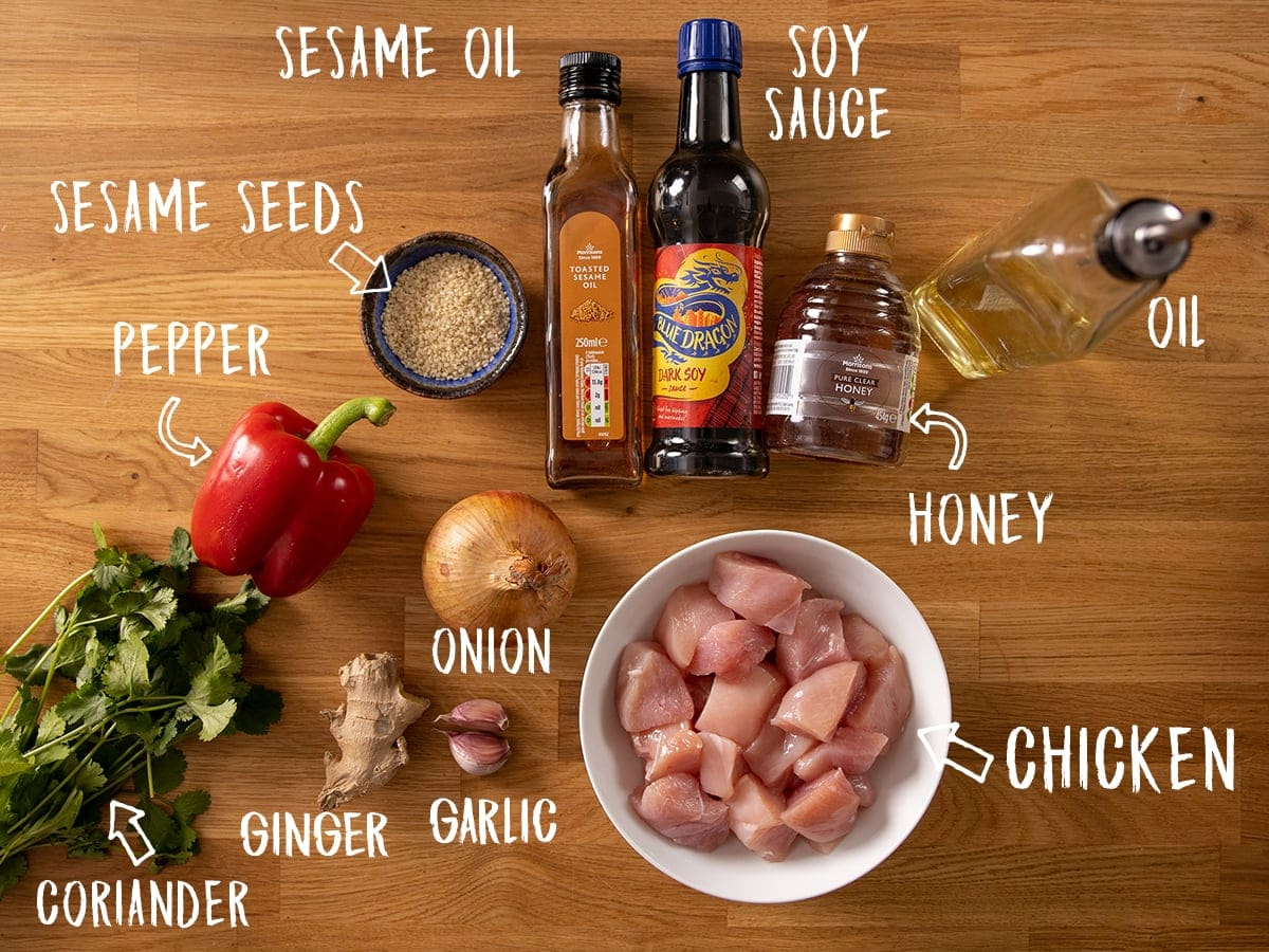 Ingredients for honey garlic chicken skewers on a wooden table