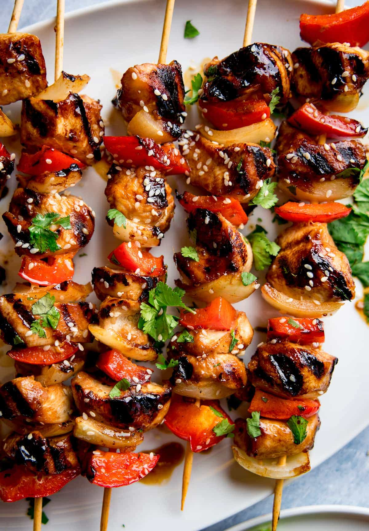 honey garlic chicken skewers with sesame seeds on top