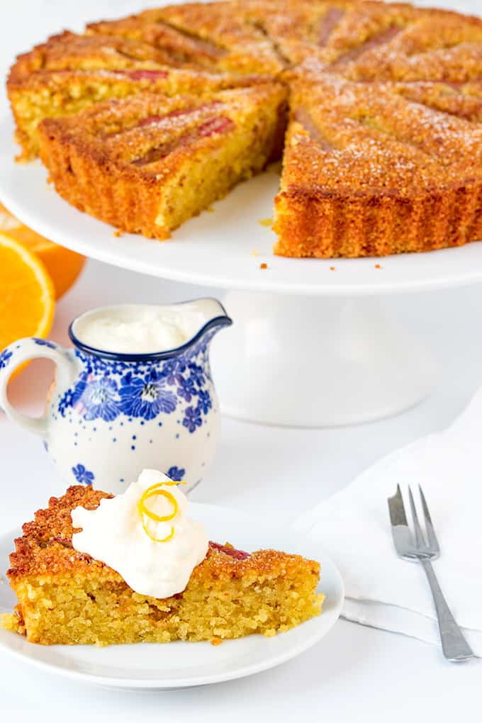 Rhubarb and Amaretti Cake, A moist, orange-infused almond cake with juicy rhubarb and amaretto cream.
