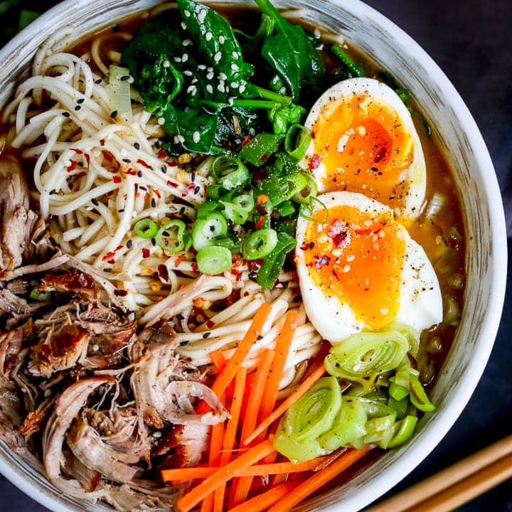 overhead picture of pork ramen with shredded meat and a boiled egg