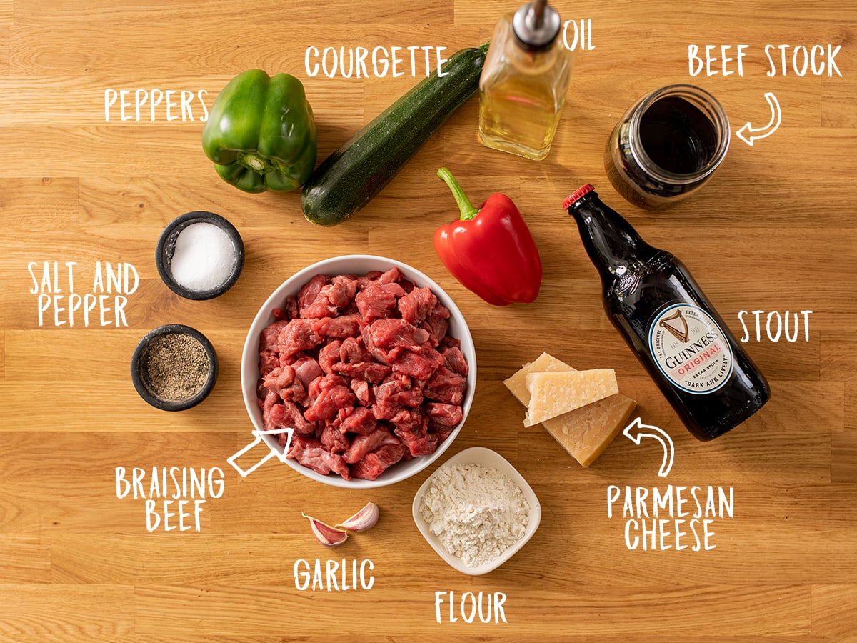 Ingredients to make summer beef casserole on a wooden table