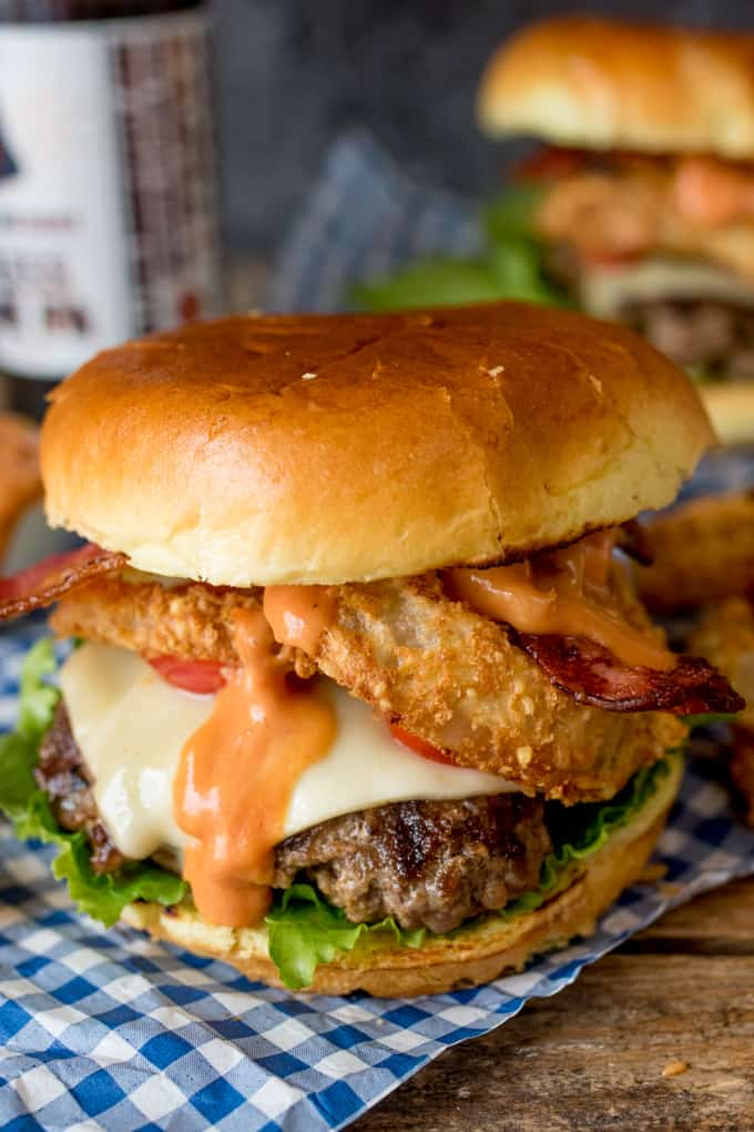 Close up photo of Bacon Cheeseburger with Baked Parmesan Onions Rings