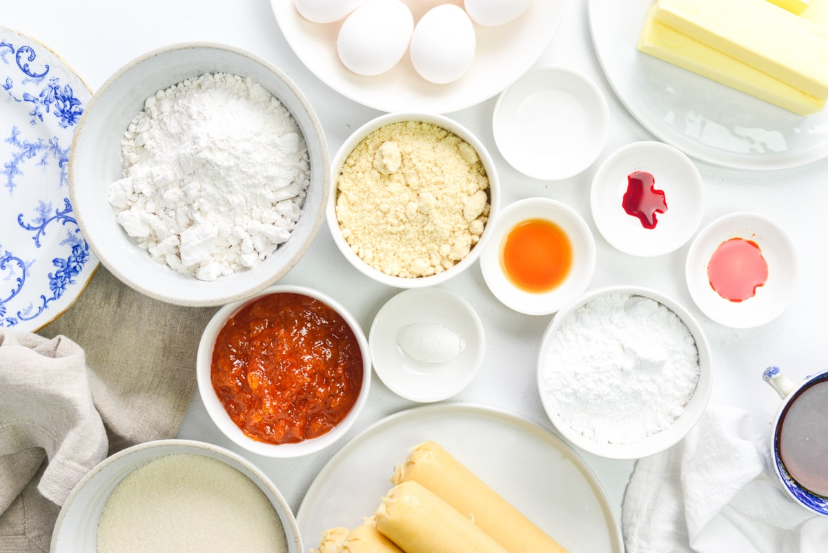 Ingredients for battenberg cake on a white table