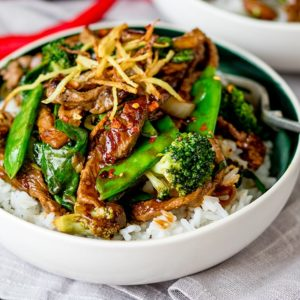 Ginger beef and broccoli in a bowl with rice