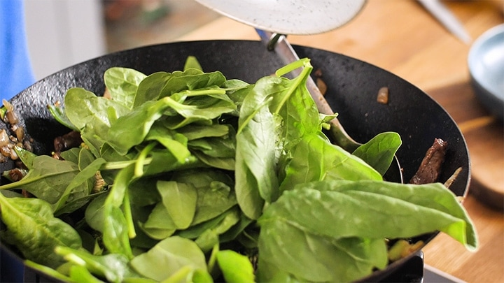 Fresh spinach in a wok
