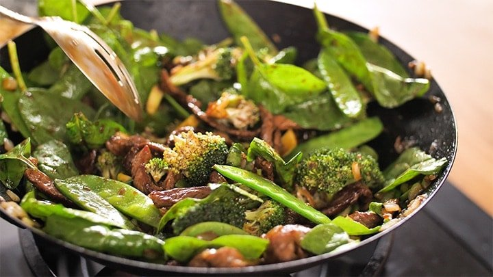 Ginger beef stir fry in a wok