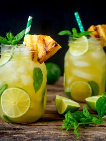 2 Pineapple Ginger Mojitos in mason jars