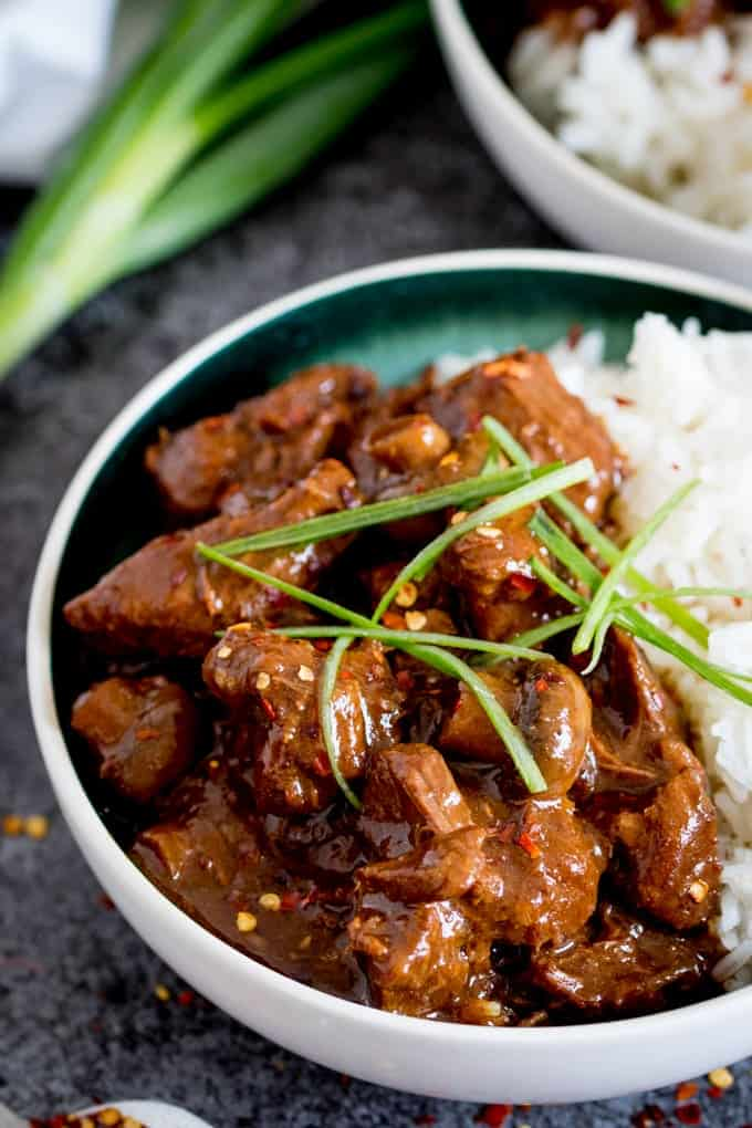 Chinese Beef in a bowl with rice and topped with spring onions