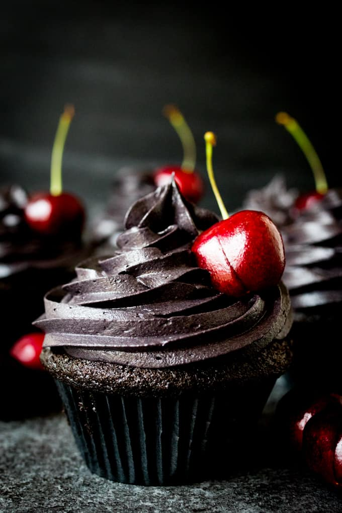 These halloween black cupcakes with cherry filling make a scrumptiously spooktacular dessert!