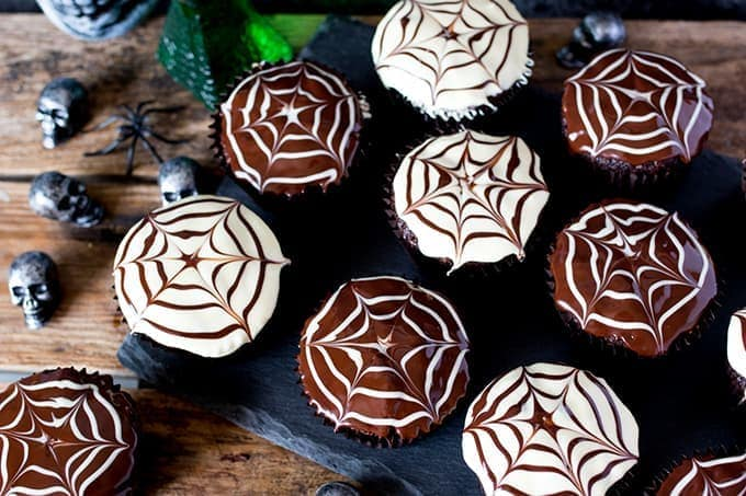 Easy to make and so striking - the kids will love helping to make these Halloween Spider Web Chocolate Cupcakes.