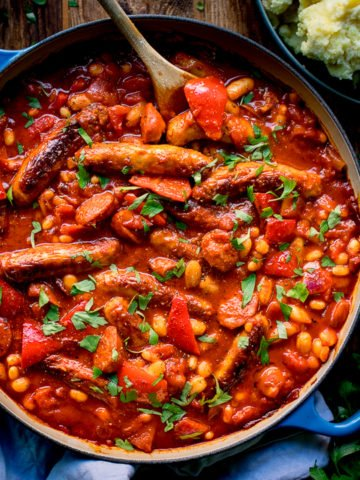 Sausage and bean casserole in a blue pan