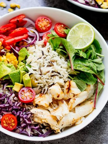 This Fish Taco Bowl with Zingy Yoghurt Dressing makes a fantastic energising dinner. Packed with healthy ingredients and gluten free too.