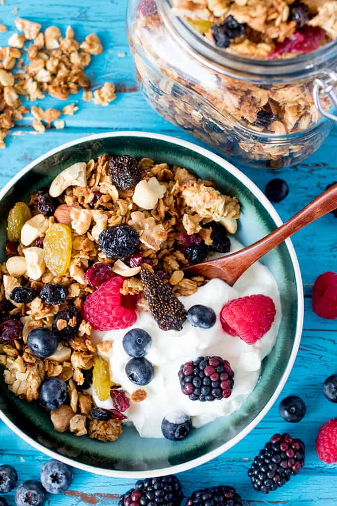 Bowl of homemade granola with fresh berries and yogurt in a bowl