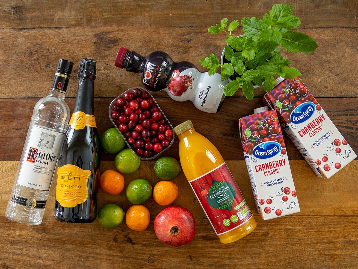 Ingredients for Christmas Punch on a wooden table