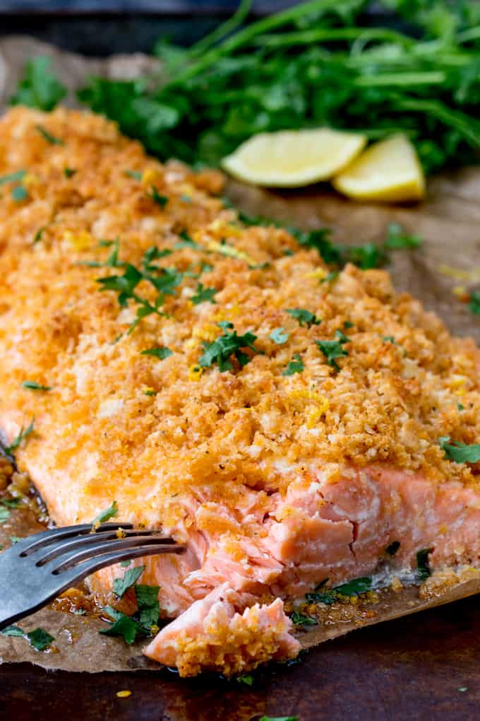 Garlic Bread Crusted Salmon with lemon and herbs in the background