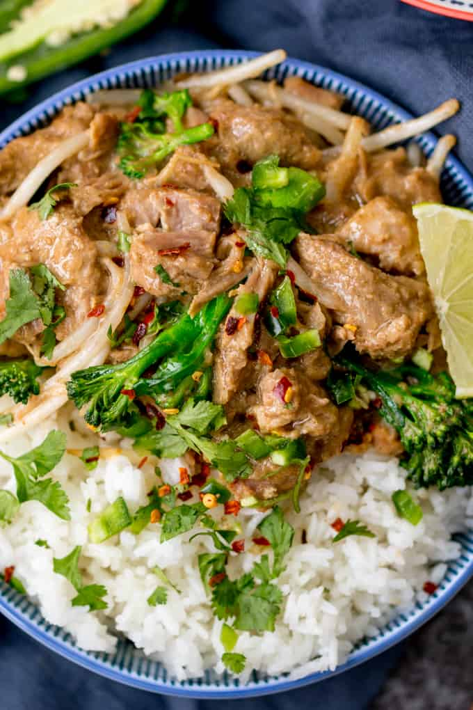 Close up overhead shot of Thai style peanut pork in a bowl with rice