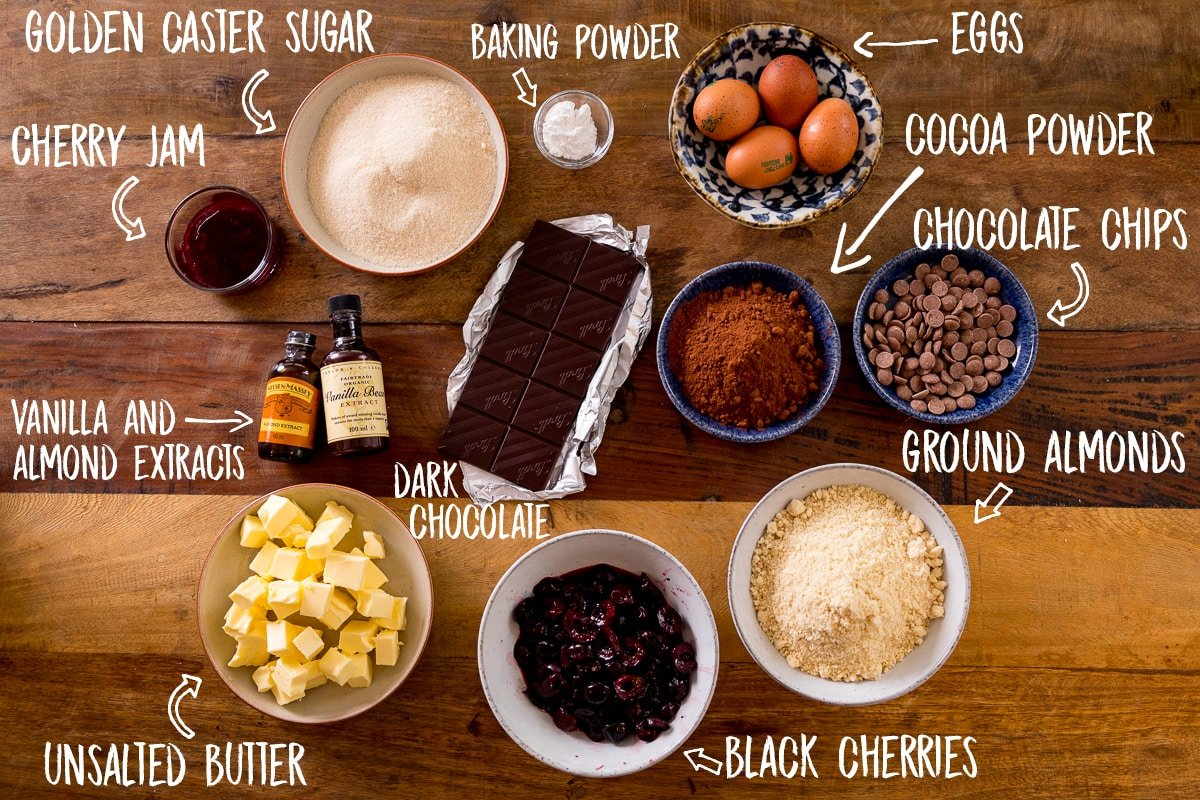 Ingredients for Chocolate Cherry Cake on a wooden table