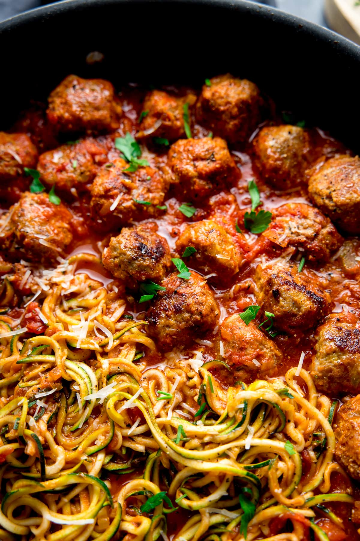 Close up image of Turkey meatballs and courgetti in a pan