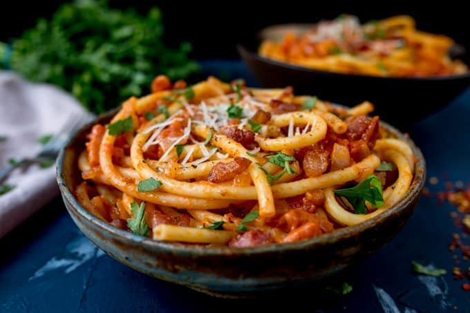 Close up side photo of Amatriciana pasta in a bowl