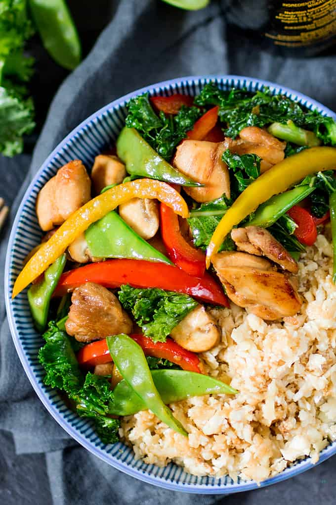 That Chinese take-away might be tempting, but this Honey and Garlic Chicken Stir Fry with Cauliflower Egg Fried Rice is just as tasty, and so much better for you!