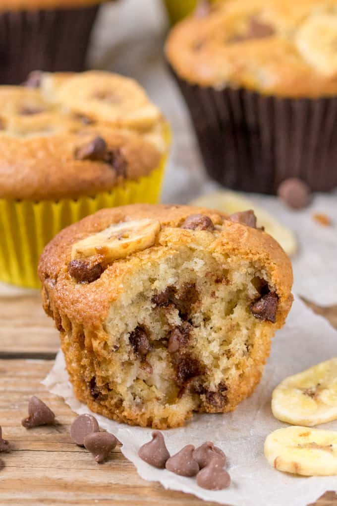 Close up picture of Light and fluffy Bakery Style Chocolate Chip Banana Muffins with a bite taken out