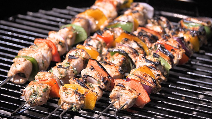 Chicken kebabs cooking on the barbecue