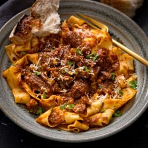 Beef ragu with pappardelle in a green bowl