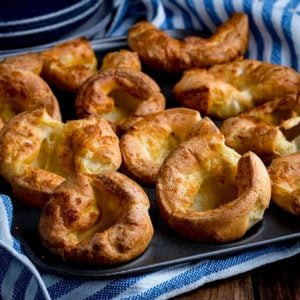 Yorkshire puddings in a tin on a wooden table