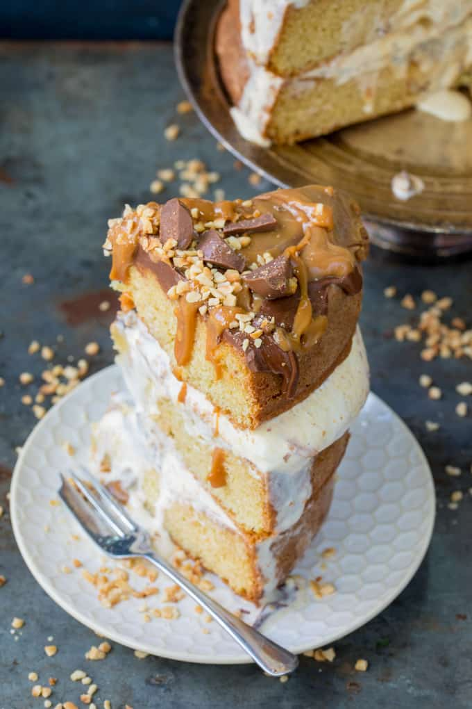 Chocolate Peanut Butter Ice Cream Cake with Salted Caramel - this three layer cake is an easy crowd-pleaser. A great Summer dessert!