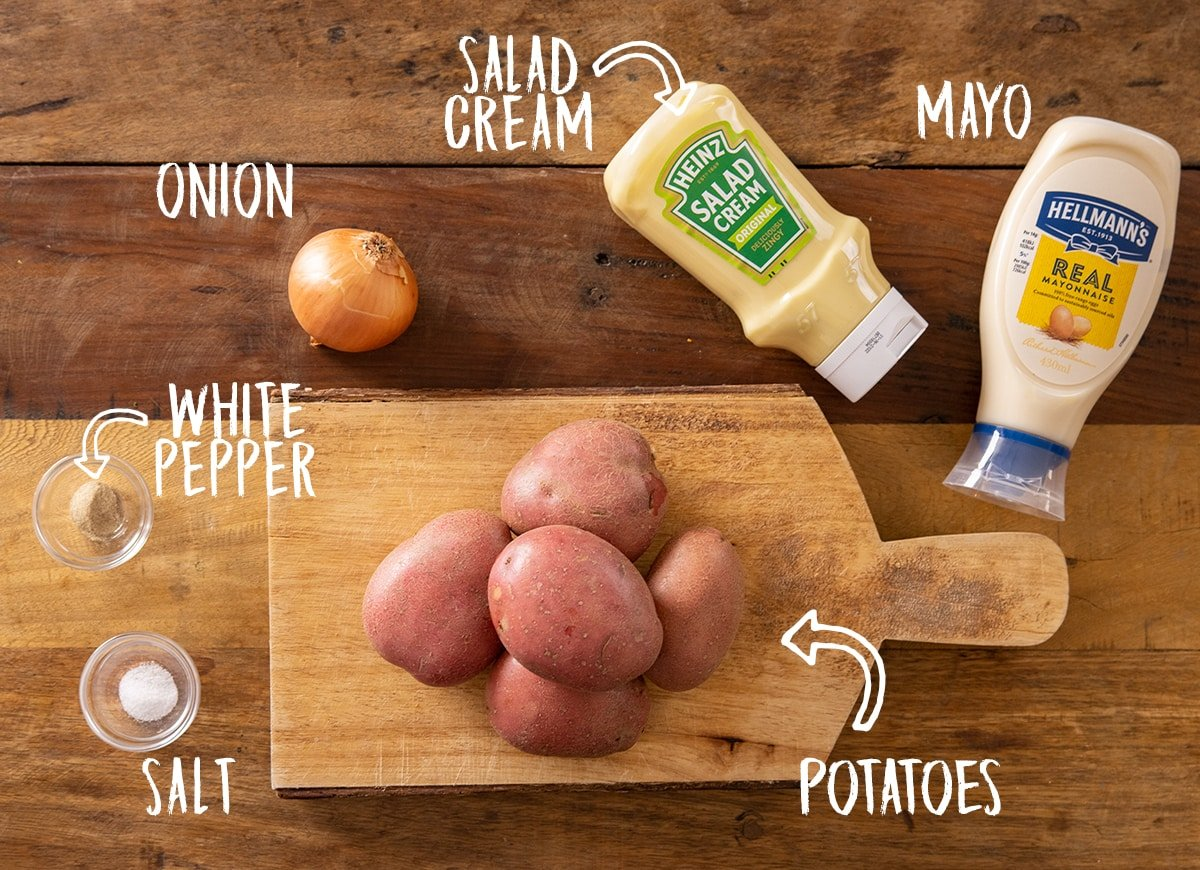 Ingredients for potato salad on a wooden table