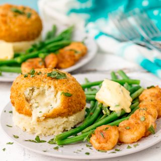 Fishcakes with Cheesy Mash and Crispy Garlic Prawns