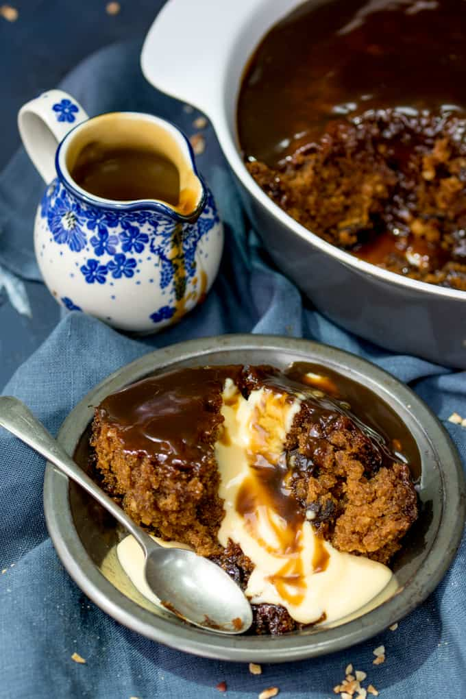 Sticky Toffee Pudding with Homemade Custard - A traditional English pudding kicked up a notch, with the addition of rum-infused raisins!