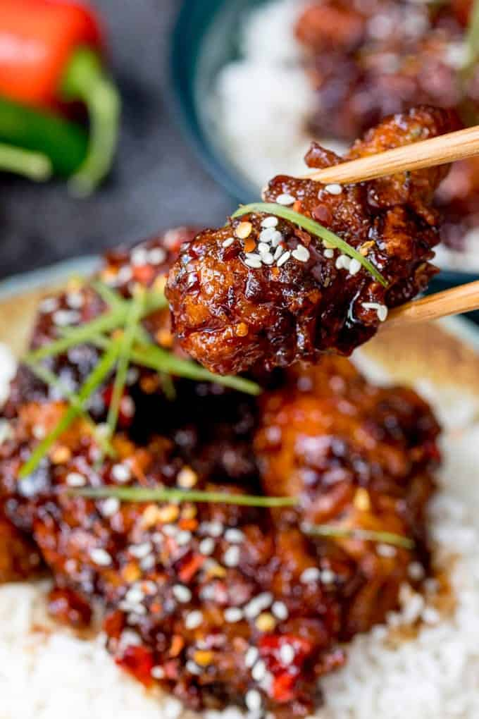Closeup of a piece of Chinese fried Chicken in a Honey Garlic Chilli Sauce