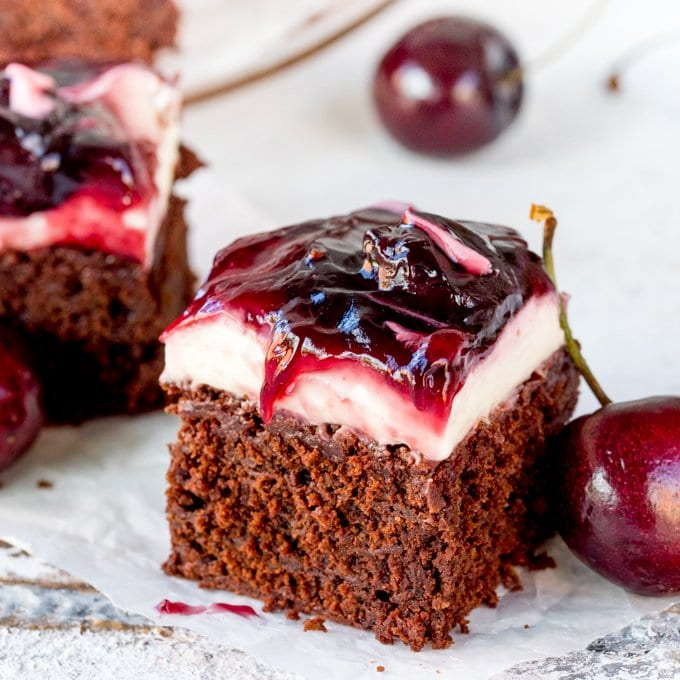 Hooray for two desserts in one with these Chocolate Cherry Cheesecake Brownies! Easily made gluten free! A brilliant party dessert!