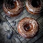 These baked Halloween Spider Web Doughnuts are easy to make and look fab on your party table!