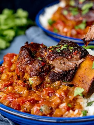 These Caramelized Slow Roast Asian Beef Short Ribs will make your house smell amazing! So tender and tasty - a great weekend dinner!