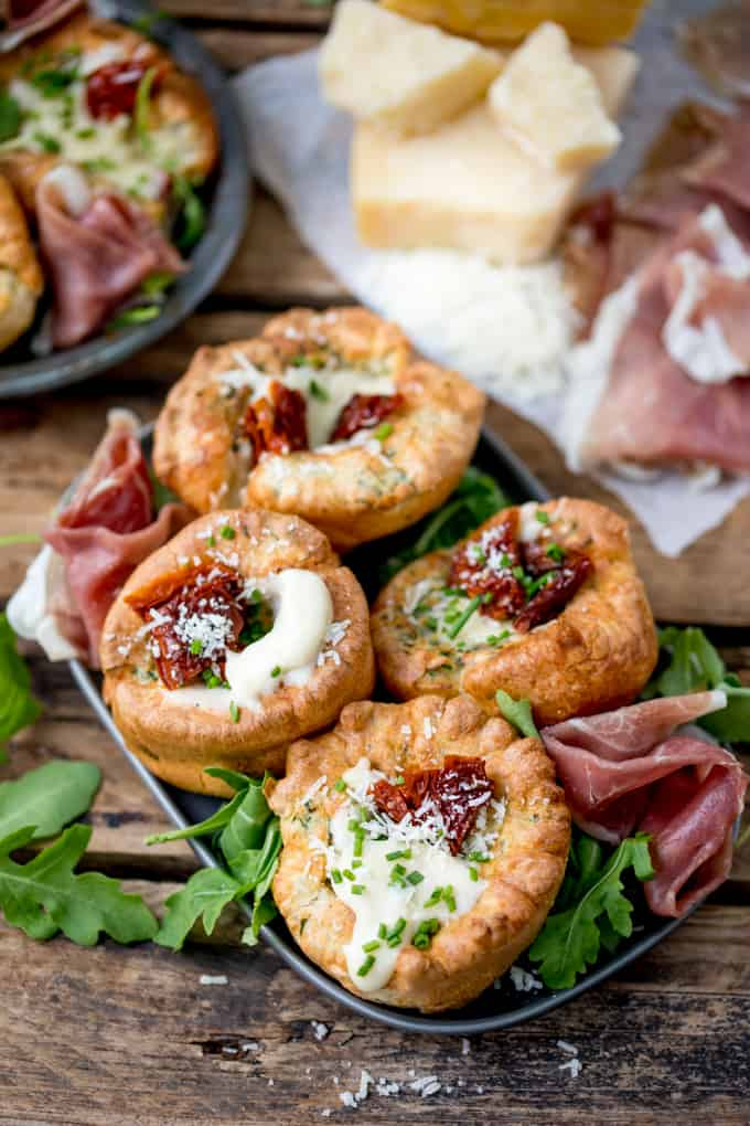 No longer a side dish, make Yorkshire Puddings the main event with these herby Yorkshire puddings, filled with cheesy béchamel and sunblush tomatoes!